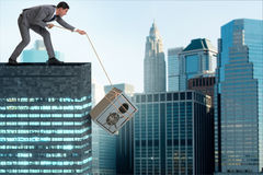 The businessman stealing safe from building. Businessman stealing safe from building Royalty Free Stock Photography