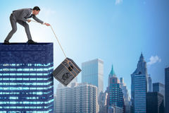 The businessman stealing safe from building. Businessman stealing safe from building Stock Photography