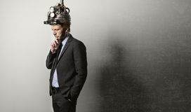 Businessman with steampunk helmet Stock Photography