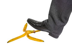 Businessman stepping on banana peel - business risk concept Stock Image