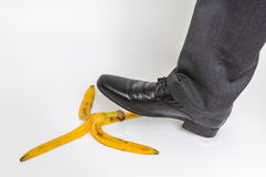 Businessman stepping on banana peel - business risk concept Royalty Free Stock Photography