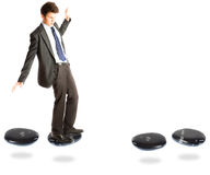 Businessman On Stepping Stones. A businessman is faltering before a gap on a stepstone path Royalty Free Stock Image