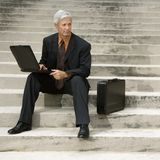 Businessman  on steps. Stock Images