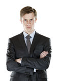 Businessman with a stern look. A young businessman with his arms crossed  a stern look. isolated on white Royalty Free Stock Photography