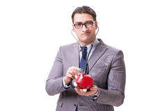 Businessman with stethoscope and piggybank isolated white backgr Stock Photos