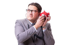 Businessman with stethoscope and piggybank isolated white backgr Stock Images
