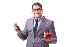 Businessman with stethoscope and piggybank isolated white backgr Royalty Free Stock Photography
