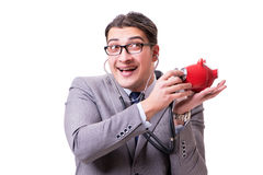 Businessman with stethoscope and piggybank isolated white backgr Royalty Free Stock Photos