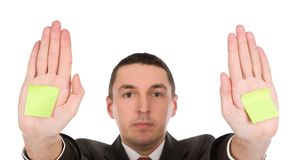 Businessman with sticker on hands Stock Images