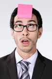 Businessman with sticky note Royalty Free Stock Image