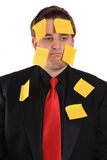 Businessman with sticky note paper on his face Royalty Free Stock Images