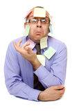 Businessman with sticky notes. Isolated on white background Royalty Free Stock Images