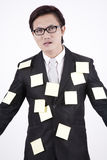 Businessman in sticky notes. Asian businessman with sticky note on his body Royalty Free Stock Photos