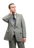 Businessman With Stiff Neck. A businessman suffering from a stiff neck, isolated against a white background Royalty Free Stock Photo