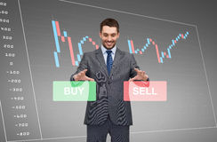 Businessman or stock broker over forex chart Stock Photo