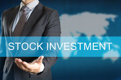 Businessman with STOCK INVESTMENT WORD Stock Photo