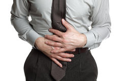 Businessman with stomach ache Stock Photos