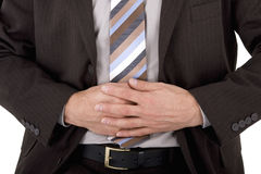 Businessman with stomach ache Stock Photography