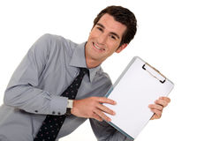 Businessman stood with clip-board Royalty Free Stock Images