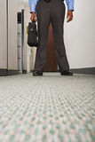 Businessman stood in corridor Royalty Free Stock Photography