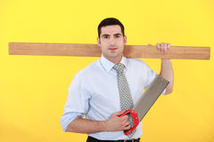 Businessman stood with saw Royalty Free Stock Image