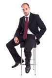 Businessman on a stool Royalty Free Stock Photo