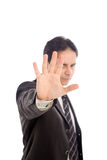 BUSINESSMAN STOP. Angry businessman saying stop with hand. Focus on hand. Isolated against white background Royalty Free Stock Photo