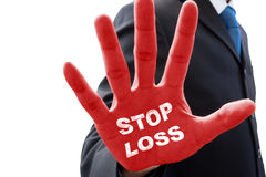 Businessman and stop loss on his hand Stock Images