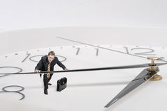 Businessman stopped time. Businessman with golden tie stopped time Stock Images