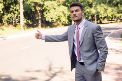 Businessman stopping car Stock Photos