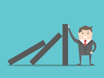 Businessman stopping domino effect. Successful strong confident businessman stopping domino effect. Business, problem, solution, crisis and risk concept. EPS 8 Stock Images