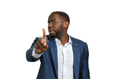 Businessman stopping with a hand gesture. Stock Photos