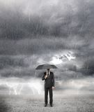 Businessman in storm Royalty Free Stock Image
