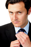 Businessman with straight face Stock Images