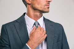 Businessman straightening his tie Royalty Free Stock Photography