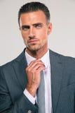 Businessman straightening his tie Stock Photo