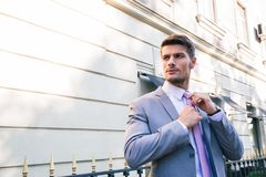 Businessman straightens his tie Stock Photography