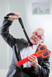 Businessman strangled by cuts and taxes Royalty Free Stock Photography