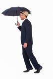Businessman in straw hat under umbrella Stock Image