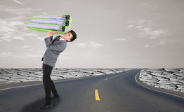 Businessman on street in hard work concept. Businessman on street with big folder in hard work concept Royalty Free Stock Images