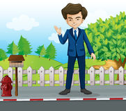 A businessman at the street standing near the mailbox Royalty Free Stock Photography