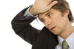 Businessman with stress. Businessman holds his hand to his head in stress Royalty Free Stock Photos