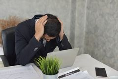 Businessman Stress from problematic work. Young businessman Stress from problematic work Show with the mod Symptoms that indicate stress Royalty Free Stock Images