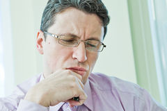 Businessman in stress thinking about problems Stock Photography
