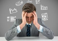 Businessman stressed with figures and charts drawings graphics Royalty Free Stock Photo