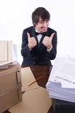 Businessman stressed in his office. Many documents on the desk Royalty Free Stock Photography