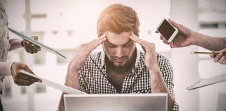 Businessman stressed out at work. In casual office royalty free stock photography