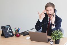 Businessman stressed out at work. stock photos