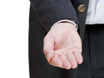 Businessman stretches handful - hand gesture Stock Photo