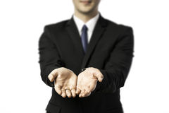 Businessman stretching out both hands Stock Images